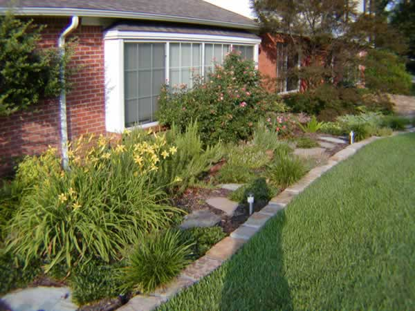 flowerbed landscaping by Grasseaters, Inc.